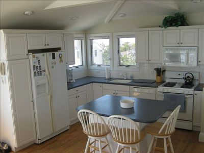 Fully equipped, bright and sunny kitchen open to the Great Room