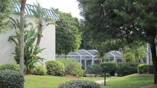 Sanibel Island condo photo - gardens, clubhouse and pool area