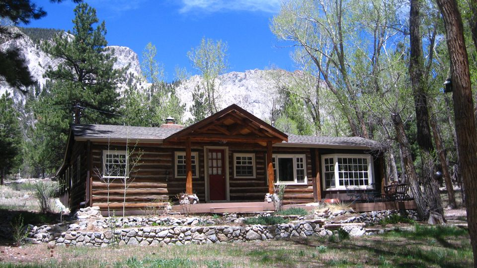 Front view of cabin with chalk cliffs behind Cabins buena vista co