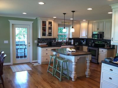 Kitchen. High end appliances, site finished hickory flooring, & custom cabinets