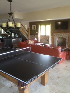 game area with pool /ping pong table and dart board