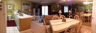 Orange Beach condo photo - View of dining area, kitchen, living room and sliding door to balcony.