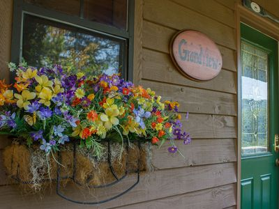 The flower box welcomes your arrival.