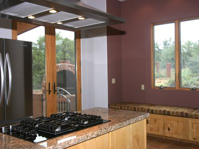 Kitchen with gas range, window seat, french doors to patio
