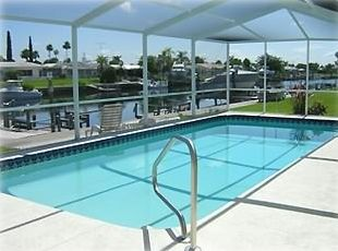 Large Screened and Heated Pool out your door, water front just steps away