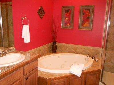 Master Bath - Jetted tub, large walk-in shower, hair dryer, robe hooks, storage