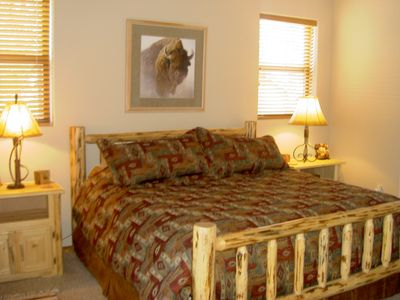Show Low cabin rental - The master suite features a king bed and quality bedding