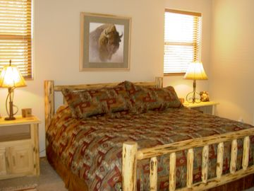 The master suite features a king bed and quality bedding