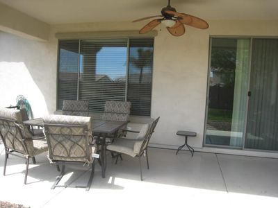 large covered patio with morning sun and seating for 6