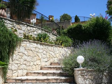 Stairs to main terrace with its lavender plants and rocky plants