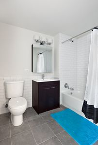 Clean modern Bathroom with shower and tub