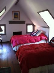 Gloucester estate photo - Twin bedroom with wide plank floors under the eaves at Mill Hill.