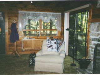 Maggie Valley cabin photo - Living room leads out to wraparound deck with gas grill and patio furniture