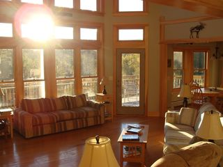 West Wardsboro house photo - Sunshiny wake up courtesy of Living Room window wall. Dining area beyond.