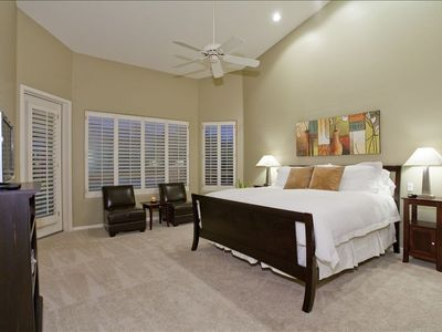 "Master Bedroom features one King bed, 26"" flat panel TV and sitting area"