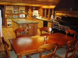 Whitefish cabin photo - Five foot pro WOLF stove w/new dishwasher, fridge and kit faucet. Island is 7'x4