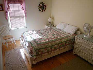 Upstairs Bedroom 3; double bed; pine floors throughout entire house.