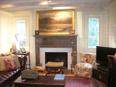 The den with  wood burning fireplace