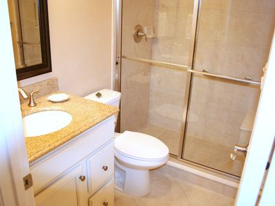 Granite countertop, walk in shower with seat.