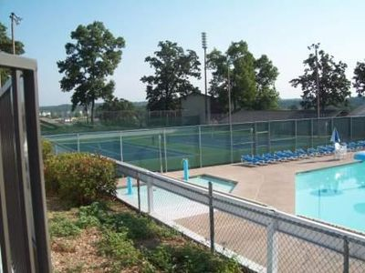 2 lighted Tennis Courts next to the pool area - also view of child's wading pool