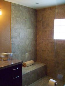 Upper Bathroom spacious walk in tile shower with glass wall...