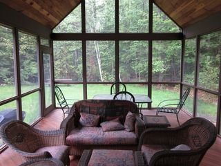Meredith house photo - Feel like your outdoors in 22' screened porch complete with furniture and TV