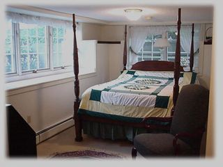Bedroom 4 with four poster queen bed and attached bath - Stowe house vacation rental photo