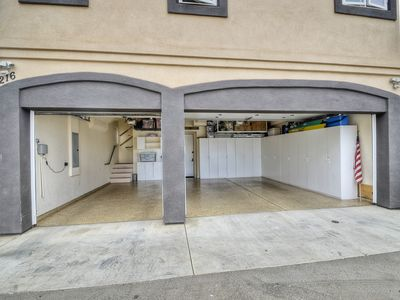 3 car garage, staircase on left goes to casita, door in center goes into villa.