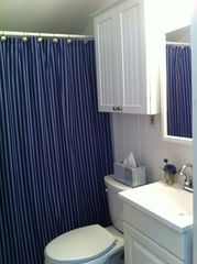 New Seabury condo photo - The bathroom is decorated in a red, white and blue color scheme.