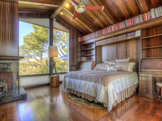 Library bedroom with custom wood floors and fireplace. - Tiburon house vacation rental photo