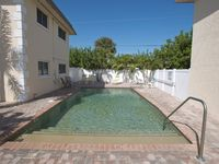 Beautiful 2 bed condo with heated pool, private patio & WIFI