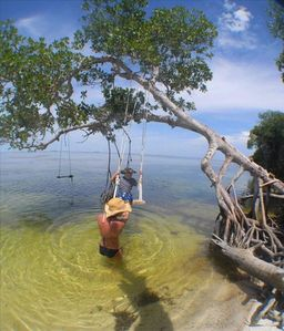 My daughter and grandson enjoy a swing at out island beach Great place to relax