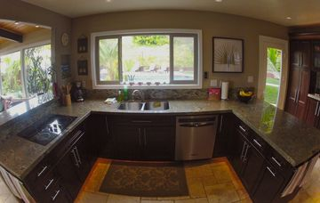 Large kitchen overlooking backyard/pool