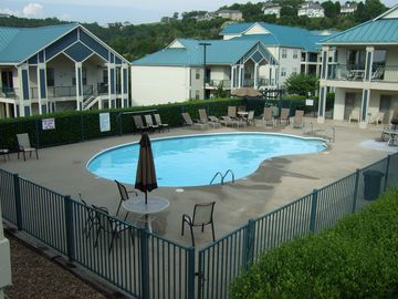 Branson condo rental - Condos have the pool on one side and the lake and marina on the other side