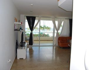 Juan Dolio condo photo - Family Room looks out to the Beach & Pool. Large flat screen TV with cable. WIFI