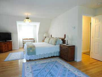 Spacious second floor master suite with king bed, flat-screen TV & private bath.