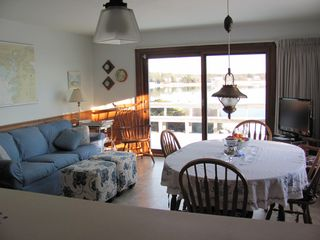 Pocasset house photo - Family room and dining area, viewed from kitchen. Opens to deck and waterfront.