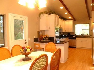 Spacious kitchen is newly remodeled w/stainless steel appliances and granite