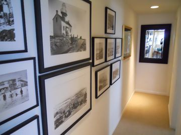Hallway gallery wall of historical Ocean Beach photos