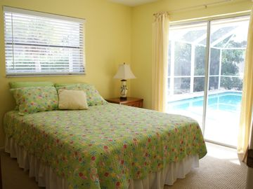 Pillowtop Queen BR w/patio doors to the pool