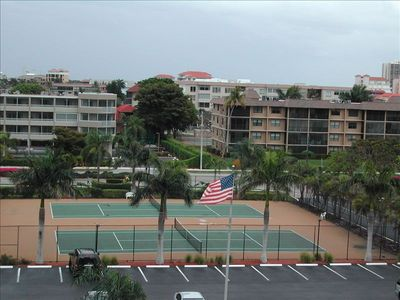 Tennis courts with view looking to street from Sea Winds building.