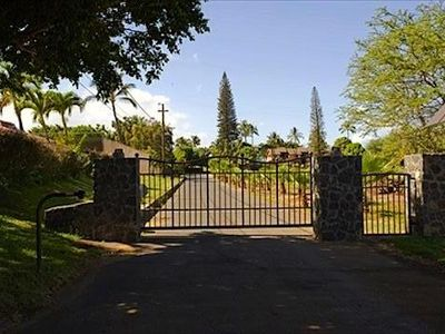 Welcome! This electronic gate will lead you to a private gated road & your home!