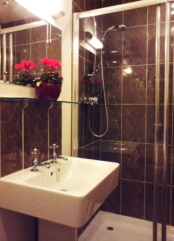 Bathroom with extra large shower area inThe water Mill with great power shower