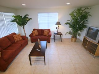 South Padre Island house photo - Upper unit - Spacious living area with large TV and queen size sleeper sofa