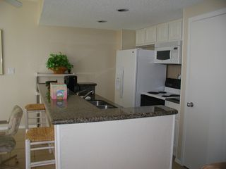 South Padre Island condo photo - Filtered water & ice in the door of the refrig. Granite Counters in the kitchen.