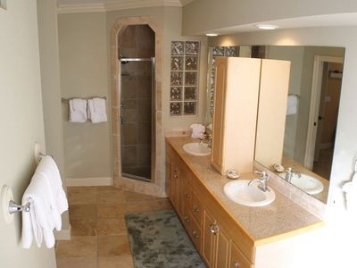Large 5 piece master bath with walk in shower, jacuzzi tub and double lavatories