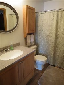 Full bath with tub and shower, upstairs with hallway access