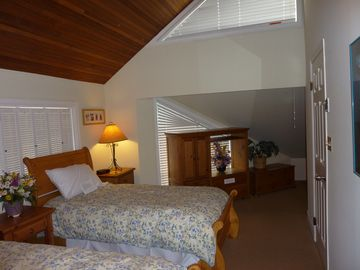 Upstairs bedroom with two twins; can sleep one or two more in loft area.