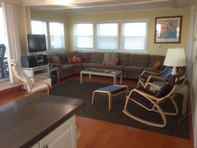 living area w/ hardwood flooring, great views of bay