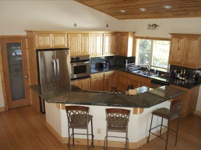 Prepare a sumptuous meal in the gourmet kitchen with granite counter tops.